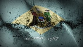 Delaware US State grunge dirty flag waving on wind. United States of America Delaware background fullscreen grease flag blowing on wind. Realistic filth fabric Royalty Free Stock Photo