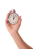 Delay. Young female with a clock in her hands Royalty Free Stock Images