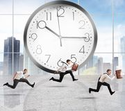 Delay. Concept of time and delay with running businessman Stock Photos