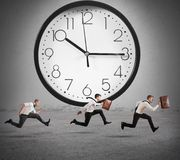 Delay. Concept of time and delay with running businessman Stock Photography