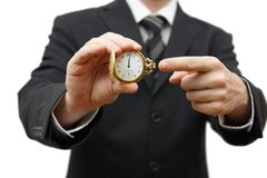 Delay or late concept with businessman showing poc. Ket watch Royalty Free Stock Photos