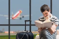 Delayed aeroplane concept. Man is sitting with baggage in airport Stock Photography