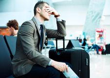 Delayed flight. Businessman sleep in airport Royalty Free Stock Image