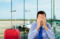 Delayed flight. Crying businessman who delayed flight at an airport Stock Images