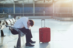 Delayed flight. Depressed passenger with problem of transportation Stock Image