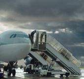 Delayed flight. Plane on stormy airport . Stock Photos