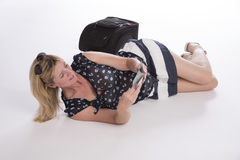 Delayed holidaymaker with passport and luggage Royalty Free Stock Image