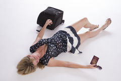 Delayed holidaymaker with passport and luggage Stock Image