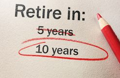 Delayed retirement concept. 10 Years text circled in red pencil -- delayed retirement concept Stock Image