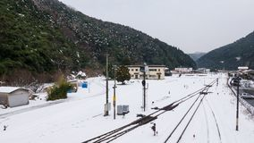 Delayed train journey due to snowstorm Snow cover the rails until the train can not be transported Royalty Free Stock Images