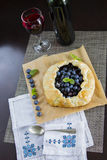 Delcious blueberries pie and wine Stock Photos