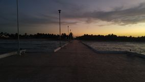 Delcuyo pier. The pier in el cuyo Yucatán mexico on evening on my travel. With a beautiful sunset or sunrise.  No editing was done or filters added Royalty Free Stock Photos