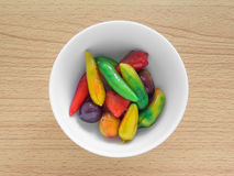 Delectable imitation fruits on woodedn table Stock Images