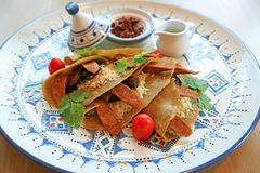 Delectable Moroccan Style Savory Crepes with Couscous, Moroccan Sausages and Eggplants. Food texture background stock images