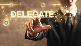 Delegate text with businessman. On dark vintage background Royalty Free Stock Photos