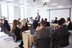 Delegates Applauding Businessman Making Presentation Royalty Free Stock Photography