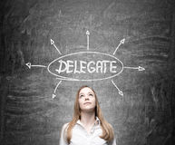 Delegating concept with thoughtful businesswoman. On chalkboard background Stock Images