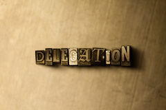 DELEGATION - close-up of grungy vintage typeset word on metal backdrop Stock Photos