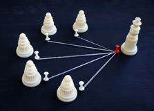 Delegation and management. Pawns and chess king. Delegation and management concept. Pawns and chess king stock photos