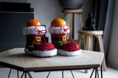 Deleite saudável do Natal O mandarino na sapata de Santa imagens de stock royalty free