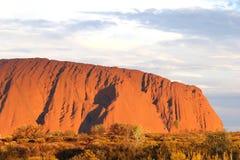 Delen av Ayers vaggar under solnedgång i Australien Arkivbild