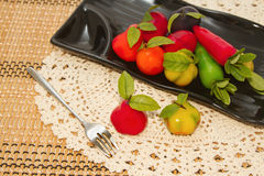 Deletable imitation fruits in black plate Royalty Free Stock Image