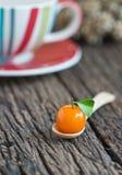 Deletable imitation fruits, Thai dessert, orange on spoon. Royalty Free Stock Image