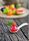 Deletable imitation fruits, Thai dessert, rose apple on spoon. Royalty Free Stock Photos