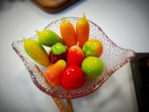 colorful deletable imitation fruits in glass Stock Photography