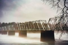 Deleware river fog engulfs bridge. Washington`s crossing at Deleware river is engulfed in fog. Moody and misty soft light Stock Photography