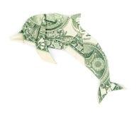 Delfín de la papiroflexia del dólar aislado Foto de archivo libre de regalías