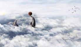 Delfin som spelar i molnen royaltyfri bild