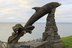 Delfinträskulptur Royaltyfri Bild