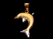 Delfinu złota breloczek Obrazy Royalty Free