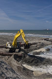 Delflandse Kust excavator. A dredgingwork in the Netherlands in a beach stock photo