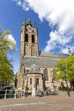 Delft church tower. Delf church tower again a blue cloudy sky with place for message at the left side Royalty Free Stock Photography