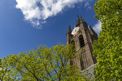 Delft church tower. Delf church tower again a blue cloudy sky with place for message at the left side Royalty Free Stock Image