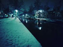 Delft city by night. Snow coverd city of Delft gives nice view at the canals by night Royalty Free Stock Image