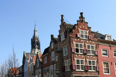 Delft Houses. Historic houses with Dutch gables and church tower in Delft stock photography