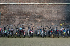 Delft. Many bicycles next to a brick wall. Holland Stock Images