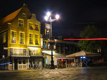 Delft market square. Old buildings and restorants in the night, Netherlands Royalty Free Stock Photo
