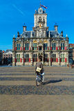 DELFT, NETHERLANDS - APRIL 4, 2008:  Young man rides a Bicycle n Royalty Free Stock Images