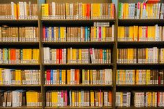 Library bookshelf`s in the community library in the city of Delft royalty free stock photo