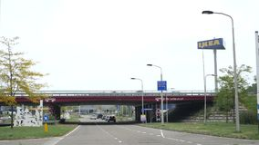 View from Dutch street in Delft to IKEA store stock footage