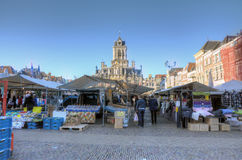 Delft. NETHERLANDS - OCTOBER 24: People in the traditional market on the main square, on October 24, 2013 in , Netherlands Royalty Free Stock Image