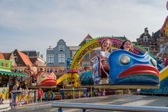 Happy girls enjoy the fair in Delft, the Netherlands. DELFT, THE NETHERLANDS - SEP 15, 2016 : Fair at the city center in Delft, the Netherlands royalty free stock photo