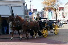 A horse carriage in central square of the old town. Delft, Netherlands - September 30 2018: A horse carriage in central square of the old town royalty free stock images