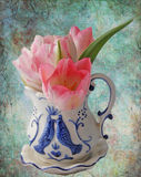 .Delft Vase with Tulips Spring bouquet with copy space Royalty Free Stock Photo