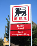 Delhaize Group Logo. AALST, BELGIUM JUNE 6: Sign outside a Delhaize supermarket in Aalst on June 6th 2013. Delhaize Group is a Belgian food retailer which Royalty Free Stock Images