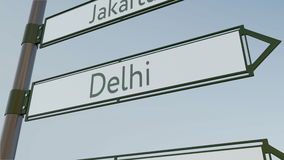 Delhi direction sign on road signpost with Asian cities captions. Conceptual 3D rendering. Delhi direction sign on road signpost with Asian cities captions Royalty Free Stock Photo